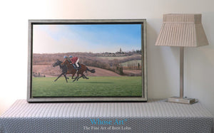 Galloping horse wall art print of two horses galloping on Epsom Downs in February. Printed on Canvas and framed in silver.