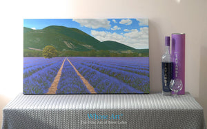 Lavender field art print on canvas. The canvas painting shows rows of lavender in the sun. It is a gallery wrap and unframed.