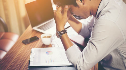 man stressed out over work