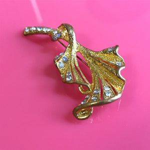 Gold flower with rhinestone detail