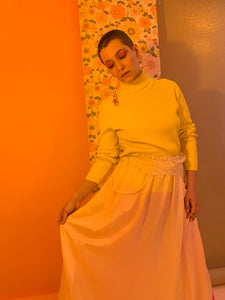 Bright yellow ribbed turtleneck