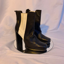 Racer stripe heeled boots