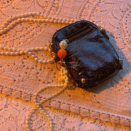 Patent pearl charm bag