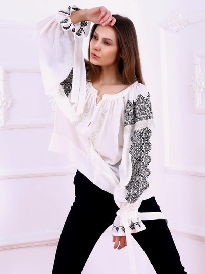 https://cdn.shopify.com/s/files/1/0119/0903/8176/files/Royal_Blouse-Black-golden_Thread_Embroidery-White-Colored_Fabric-FLORII.mp4?v=1592122306