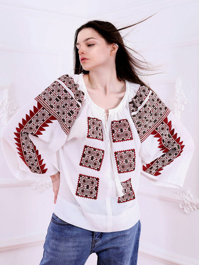 https://cdn.shopify.com/s/files/1/0119/0903/8176/files/Beauty_Emergence_Blouse-Marsala_Red-Emerald_Embroidery-White-Colored_Fabric-FLORII.mp4?v=1592122401