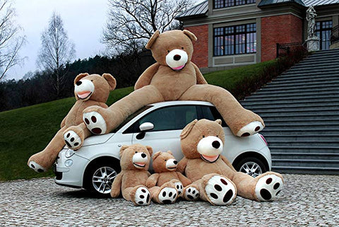 Giant teddy bears on a car