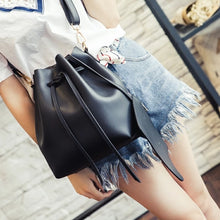 Load image into Gallery viewer, Black faux leather bucket shoulder bag