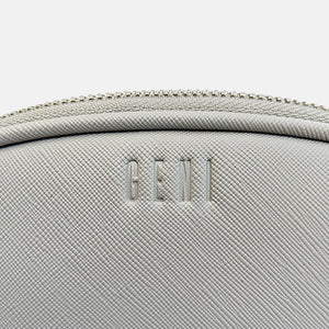 Grey faux leather makeup bag by Geni