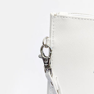 It's what's on the inside that counts faux leather white pouch