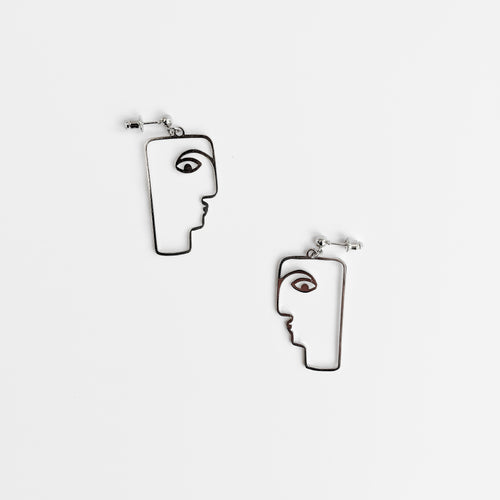 Face design earrings in silver
