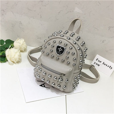 Studded faux leather backpack in grey