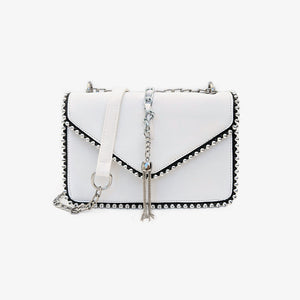 White studded shoulder bag with a chain strap