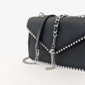 Black studded shoulder bag with a chain strap