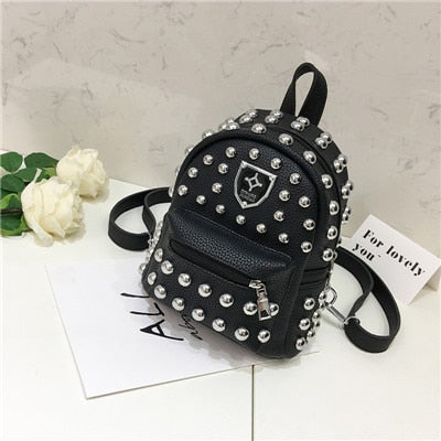 Studded faux leather backpack in black