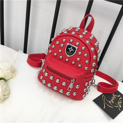 Studded faux leather backpack in red