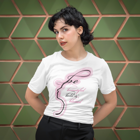 A woman wearing a white be bold beautiful and blessed t shirt