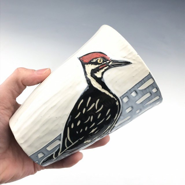 Handmade ceramic pileated woodpecker pint tumbler in sgraffito black white and red