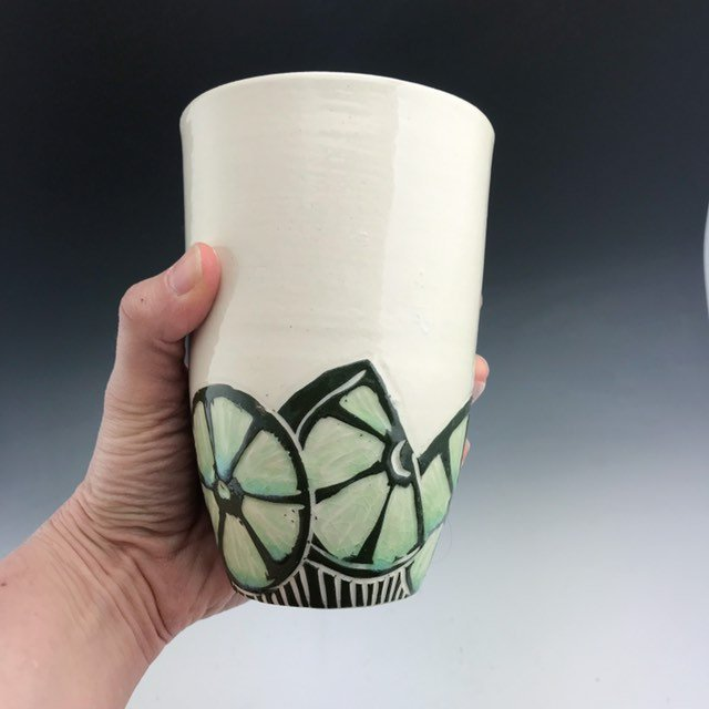 Handmade ceramic lime pint tumbler in sgraffito with green glaze interior