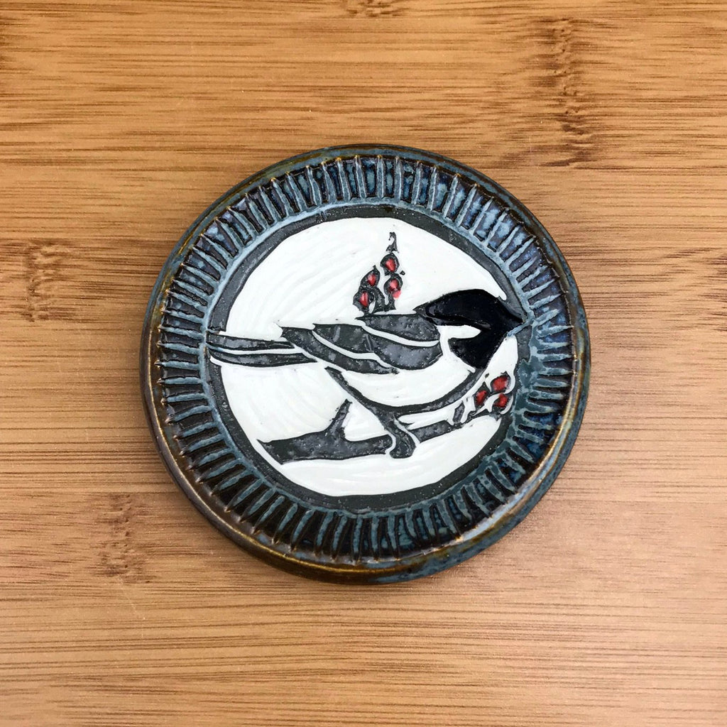 Small sgraffito pottery dish chickadee in gray glaze