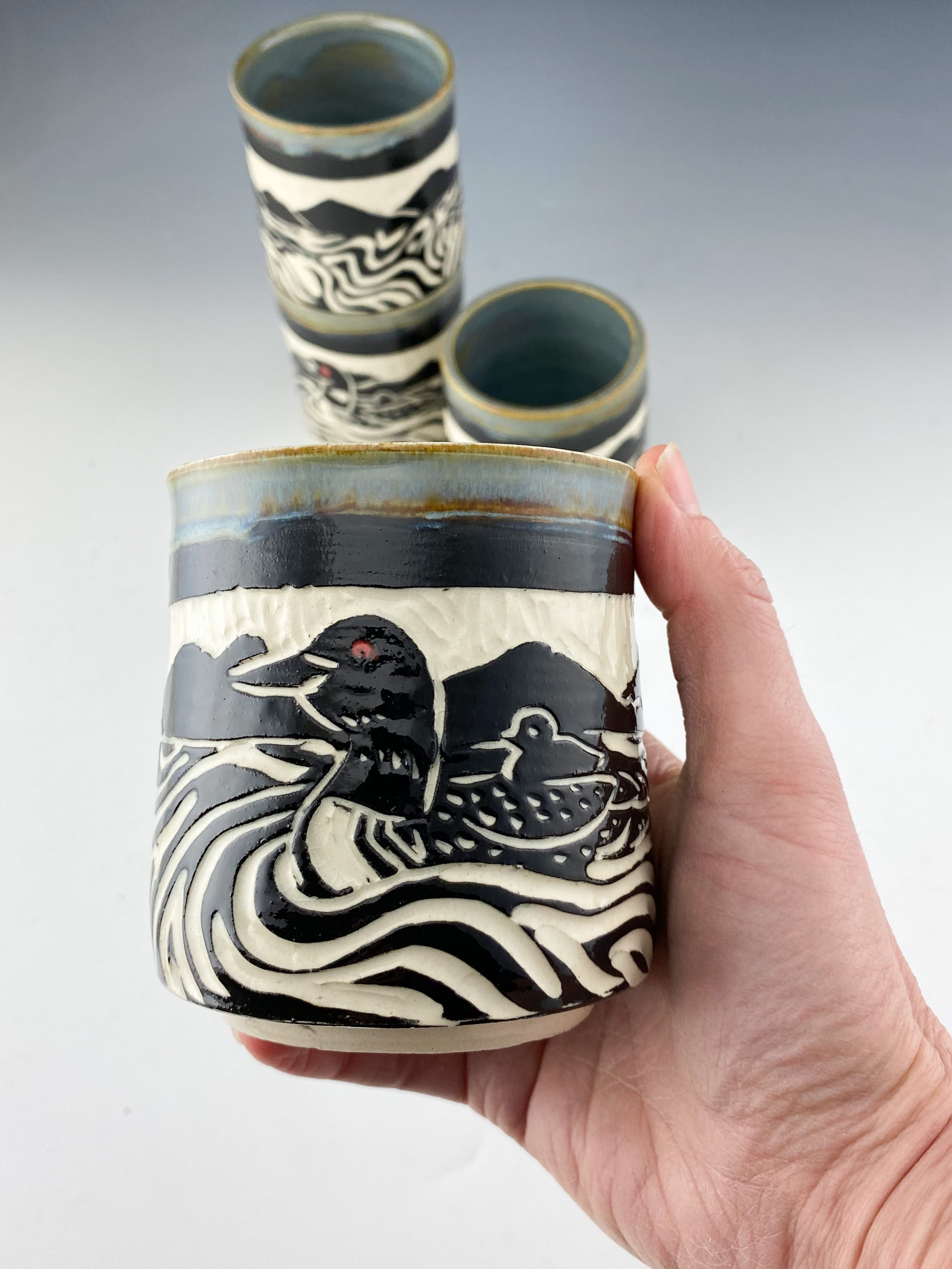 Handmade ceramic loon stacking tumblers in gray