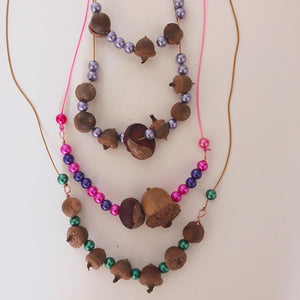 necklaces made with drilled acorns