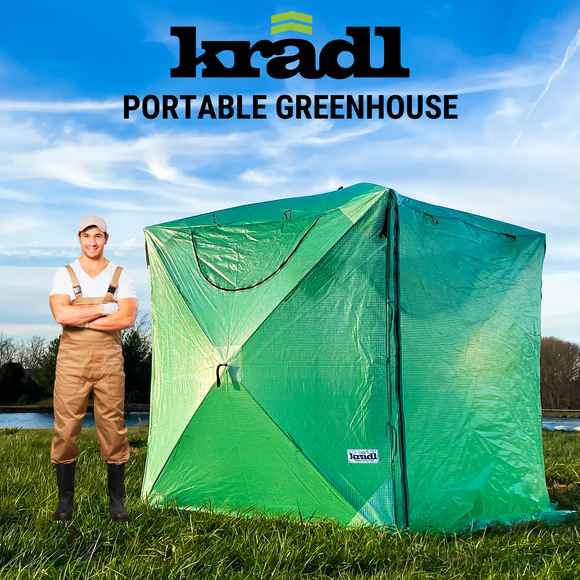 man standing in front of portable greenhouse tent