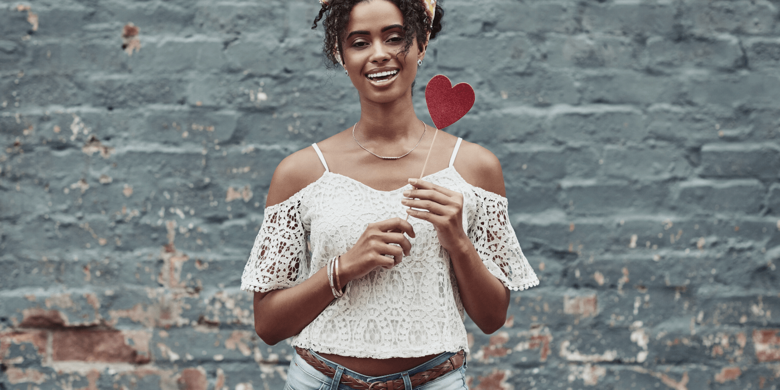 woman holding red heart showing self love and self care