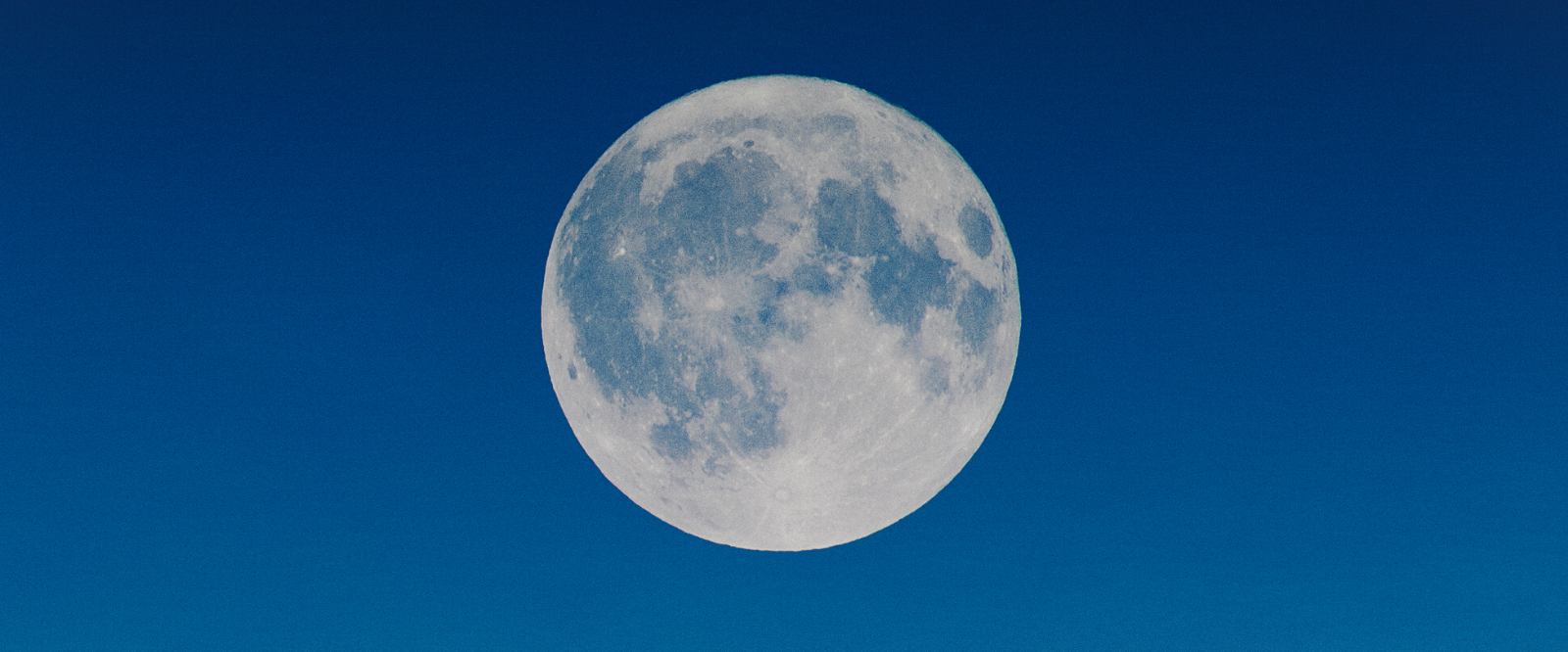full moon against blue sky for use in organic skin care preparations