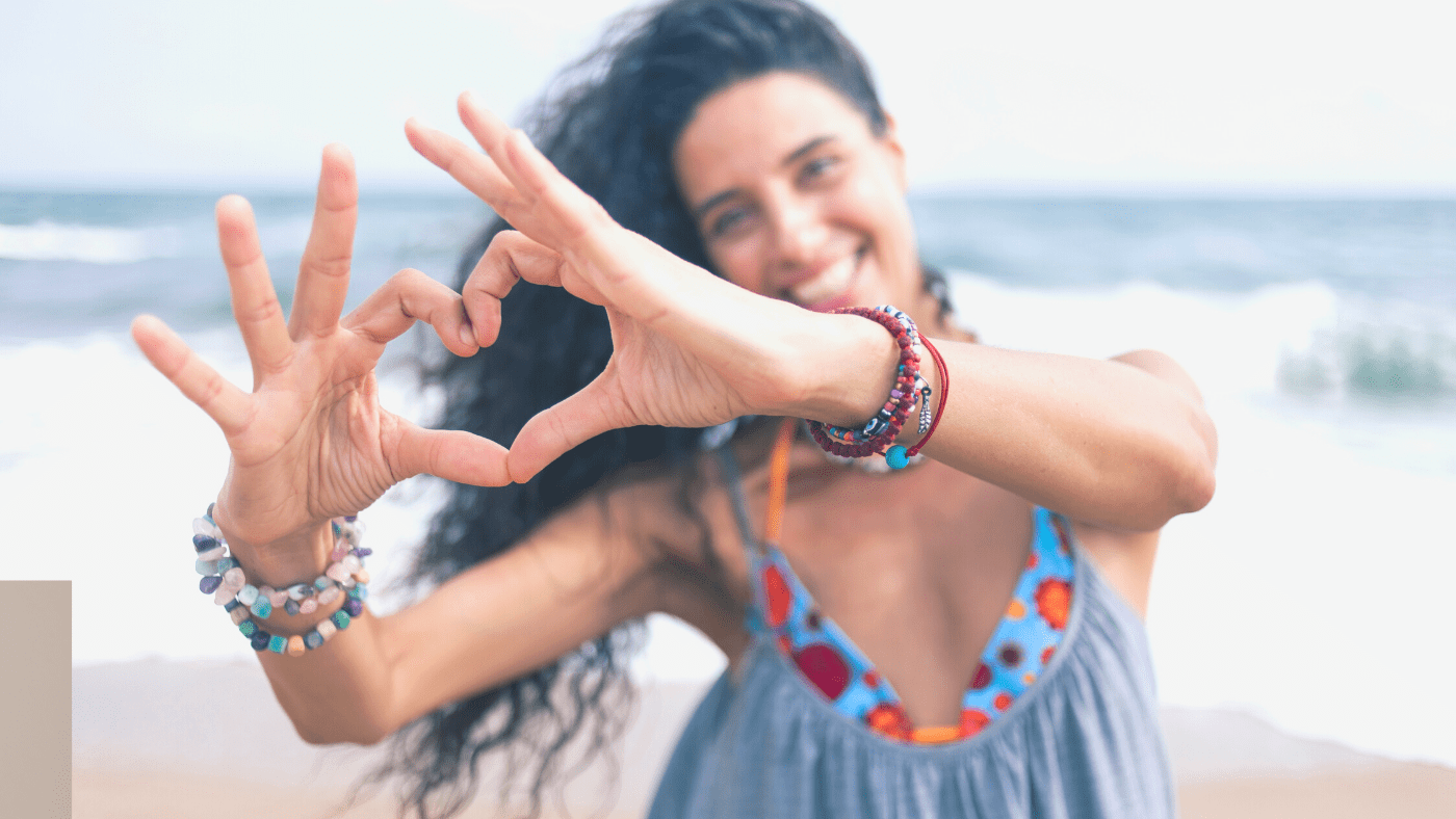 happy lady making heart with fingers