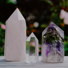 crystals lined up outside our holistic skincare studio with herbs behind