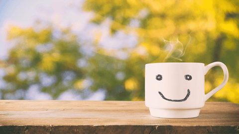 mug with smiley face on the front