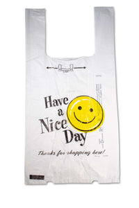 "Large, flat, plastic bags with a happy face and the phrase ""Have a nice day""."