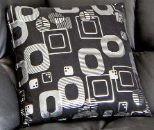 Black Coloured Cushion With Patterns