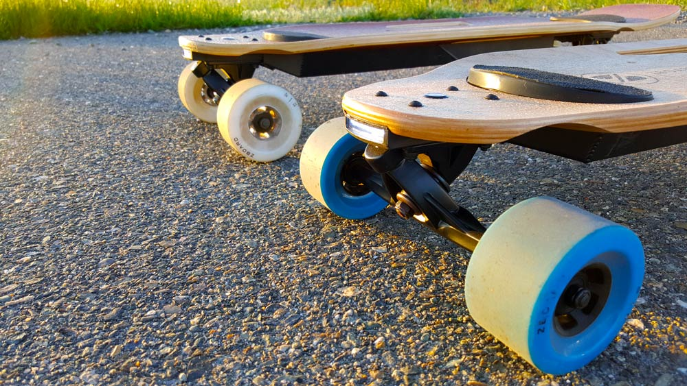 two electric skateboards