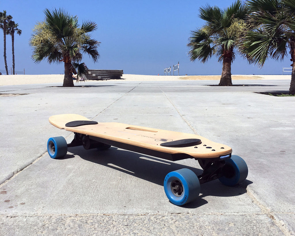 fast electric skateboard at beach