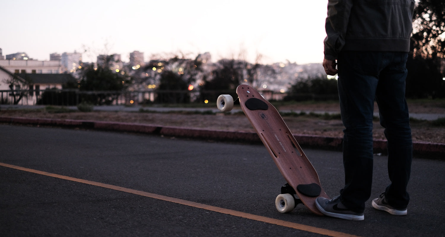 riding electric skateboard in city