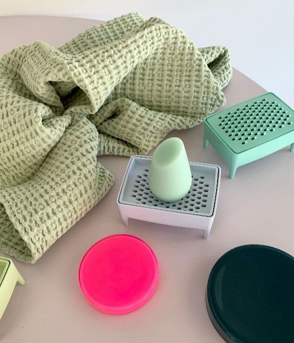 a waffle texture towel next to a soap dish and some little containers
