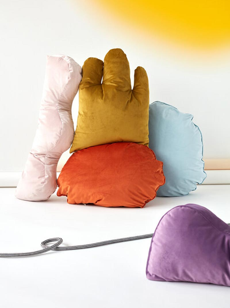 a pile of squishy, cushions in odd round shapes and fun colors