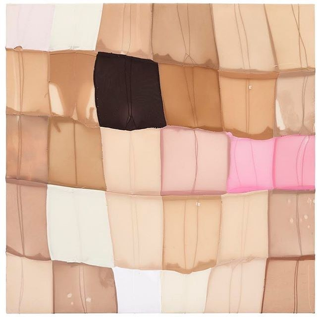 quilt made of stitched-together panty hose of different colors