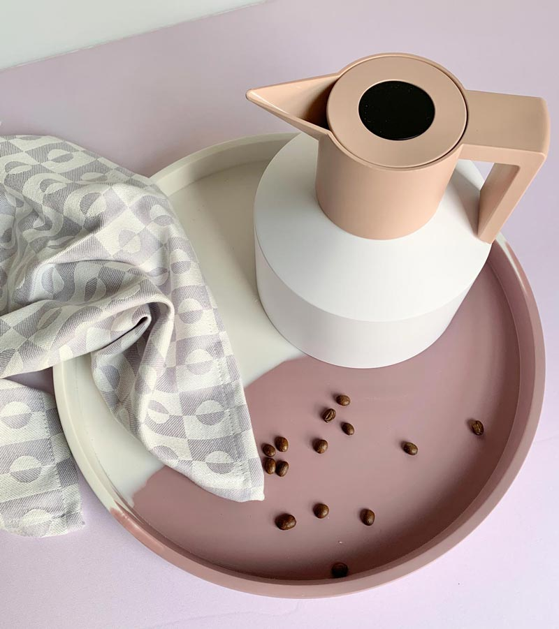 geo flask on a tray with a tea towel and coffee beans