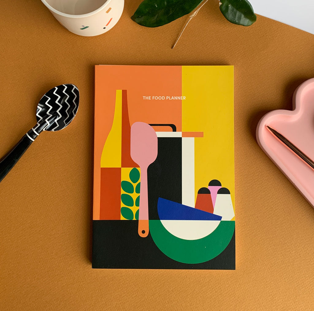 a colorful journal titled Food Planner