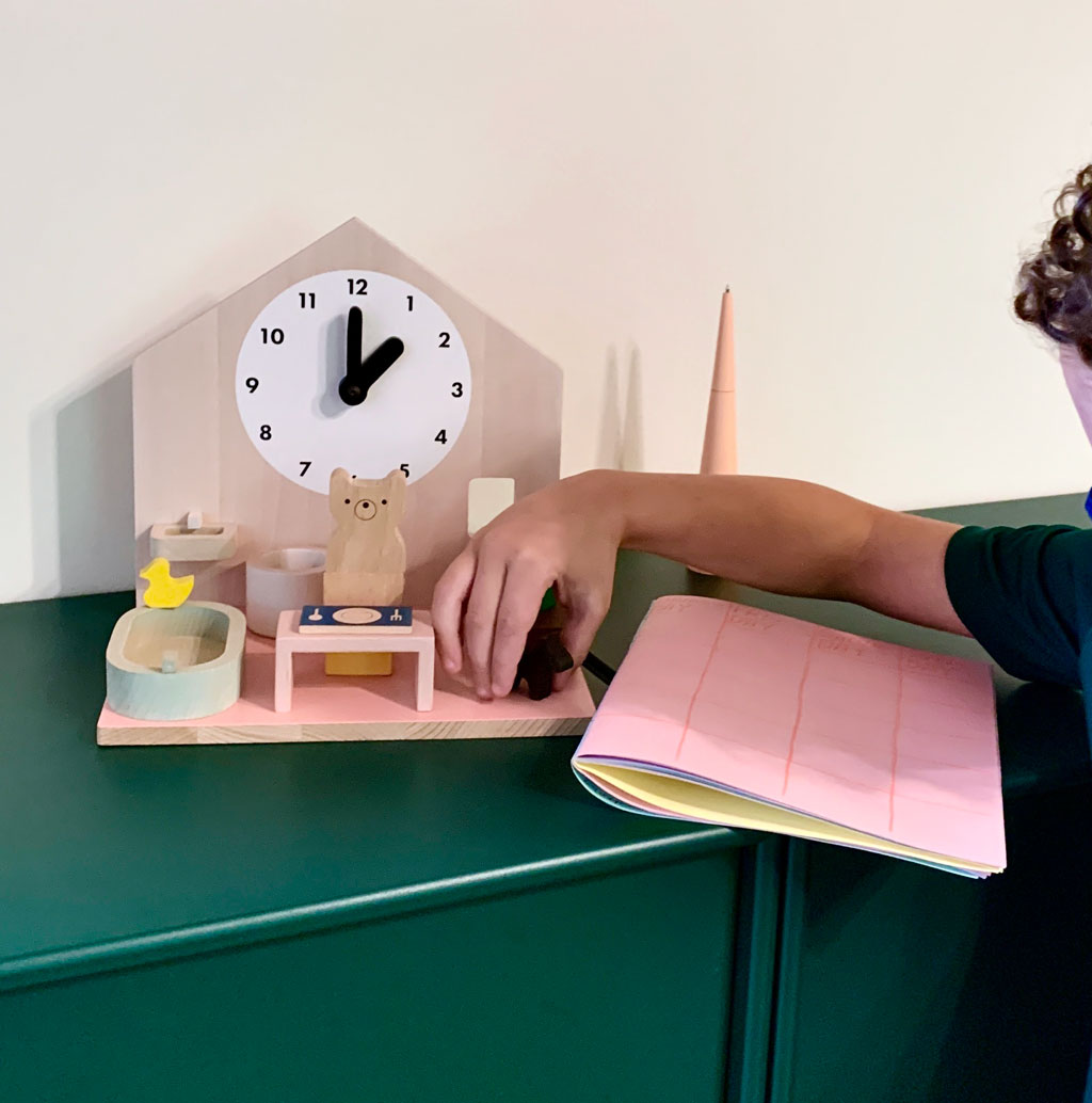 a 3DClock that comes with figurines that kids can move through a bedroom, dining room, bathroom