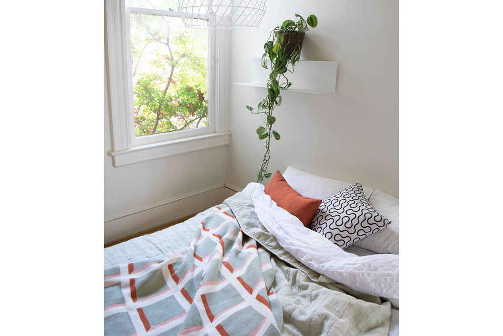 sage, green, grounding, grid, blanket, bed, plant, shelf, window, sunlight, serene, rust, color