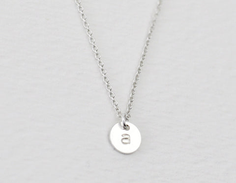 Teeny tiny silver initial disc necklace