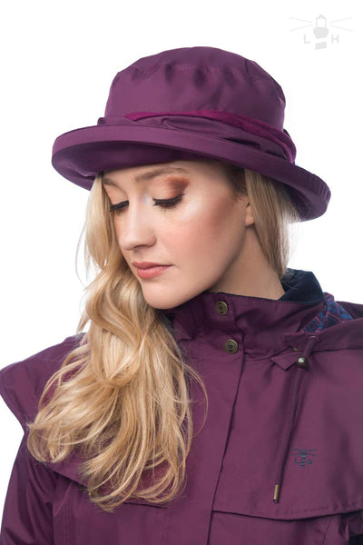 Lighthouse Womens Canterbury Cloche Hat in Purple. 43c6eb217dc