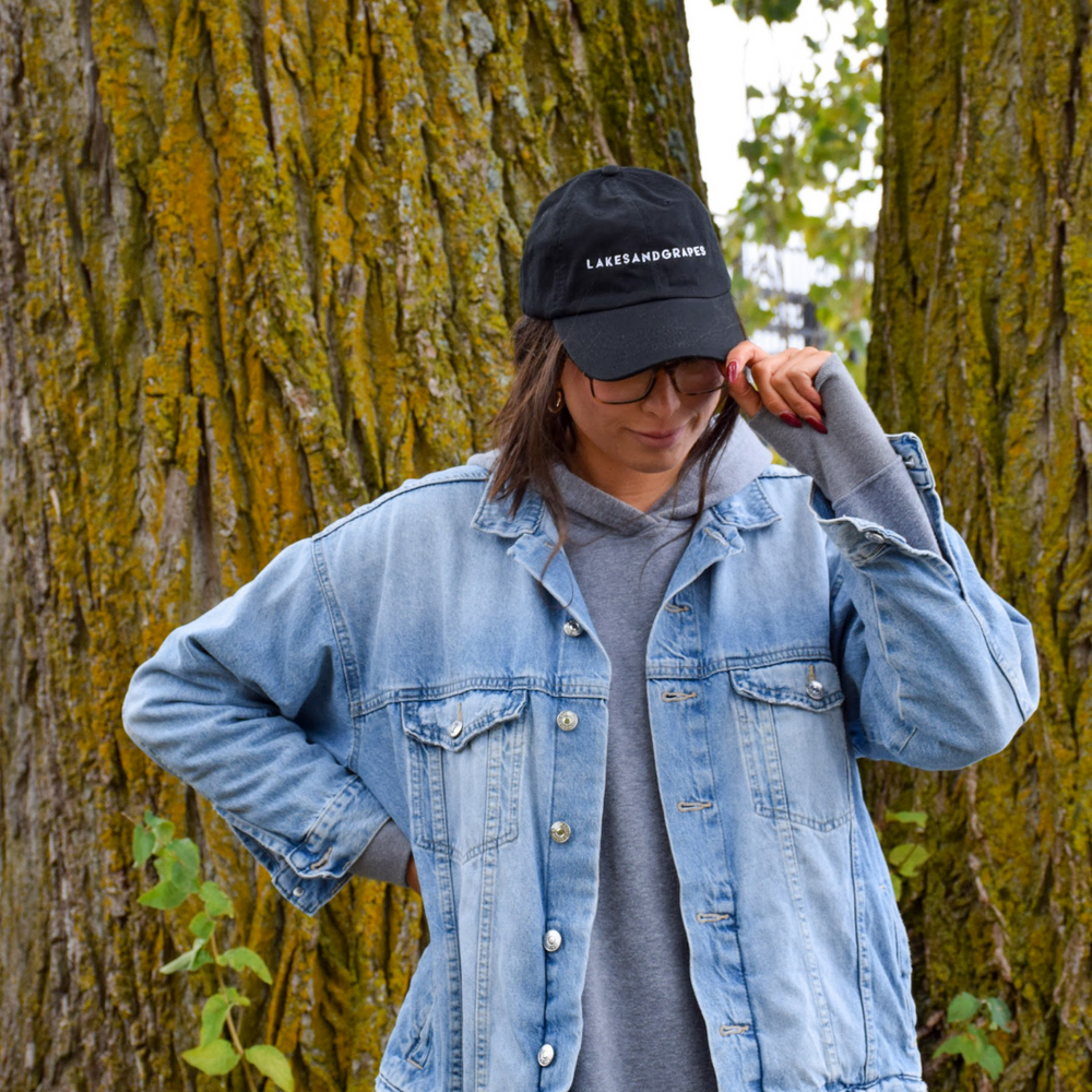 Wear this Lakes and Grapes classic black cap on any adventure, from the lakeshore to the woods of Northern Michigan.