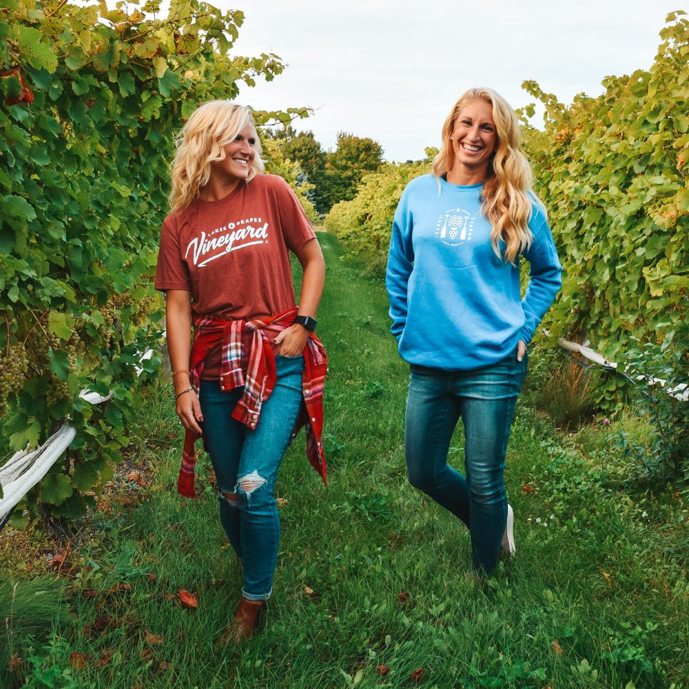 Wine Tasting in Northern Michigan in the Fall and wearing the Lakes and Grapes Vineyard Tee- Clay