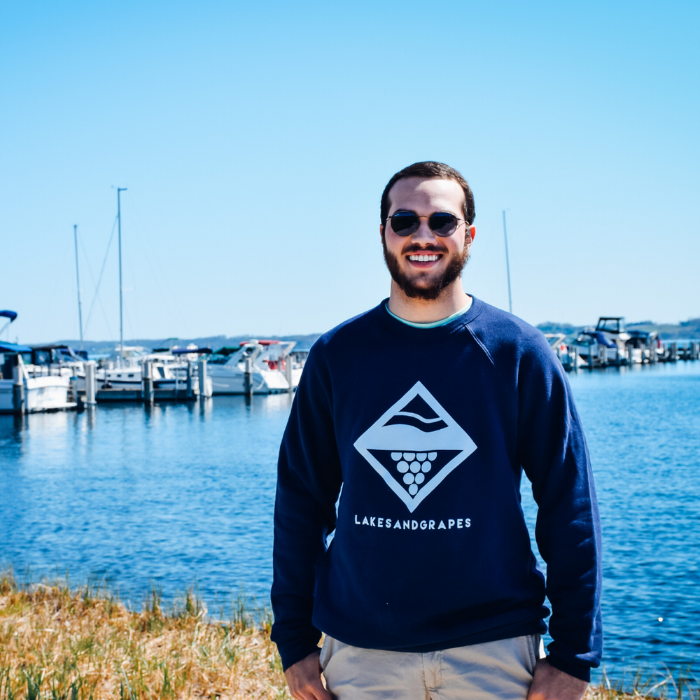 Lakes and Grapes lake diamond crew in navy with white logo and lettering.