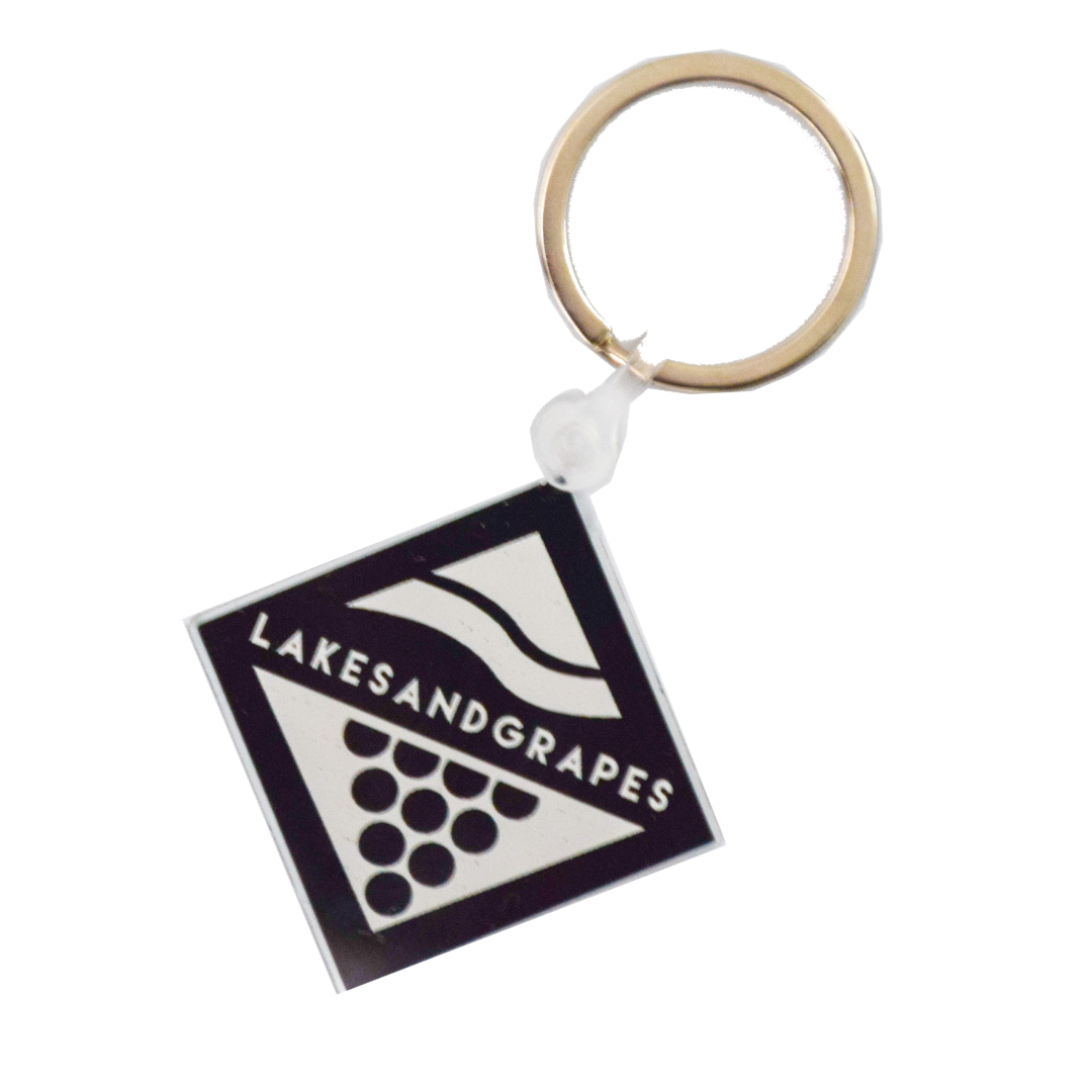 Lakes and Grapes black and white logo keychain.