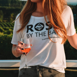The Lakes and Grapes Rosé By The Bay Women's Slouchy Tee - White perfect for wine tasting in Traverse City